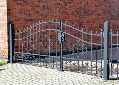 27016545 - forged iron gate outdoor. black grey fence.